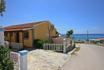 Detailed description of Corfu Apartments Spiros & Polyxeni in Agios Georgios Pagon (Pagi) in direct beach location, partially with sea view with many pictures.