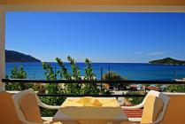 Detailed description of the Corfu Studios Stavroula in Agios Georgios Pagon (Pagi) in a beachfront location with a great sea view with many pictures