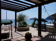 Detailed description of Corfu Apartments Evgenios in beachfront location in Agios Georgios Pagon (Pagi) with sea view and with many pictures.