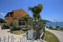 Detailed description of Corfu Apartments Spiros & Polyxeni in Agios Georgios Pagon (Pagi) in direct beachfront location with great sea view with many pictures.