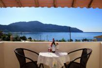 Detailed description of Corfu Hotel Liangos in Agios Georgios Pagon (Pagi) in direct beach location with sea view with many pictures
